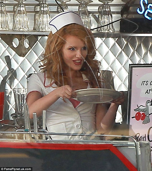 Soda fountain belle: Bella donned a saucy look in a waitress outfit while filming her latest music video on the outskirts of LA last Sunday