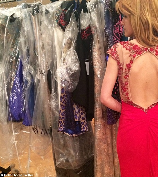 Prom princess: Bella Thorne shared a glimpse of the gorgeous red and embroidered gown she plans to wear to her prom