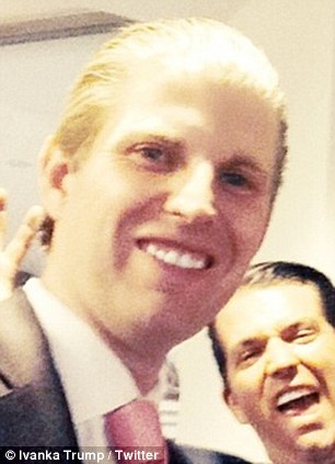All smiles: Complete with sparkling white teeth, slick-back blonde hair and a glowing complexion Eric Trump appears to be the spitting image of his father in this new family selfie - he appears alongside his older siblings, Donald Jr. and Ivanka