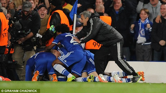 Instructions: Mourinho spoke to his players as they defended their lead in the dying minutes