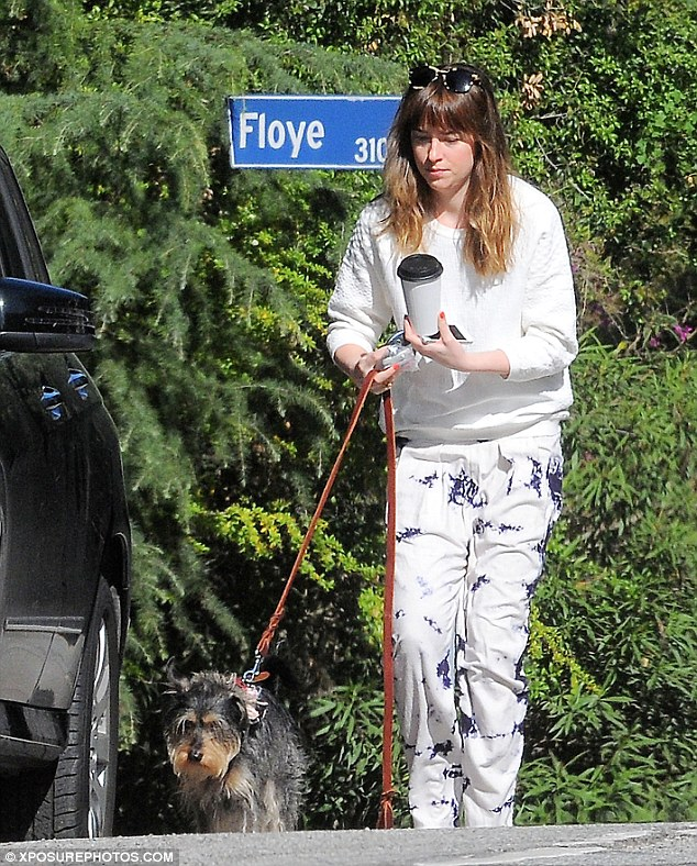 Comfort is key: Dakota Johnson opted for something comfortable to wear as she stepped out on Monday to grab coffee and walk her dog