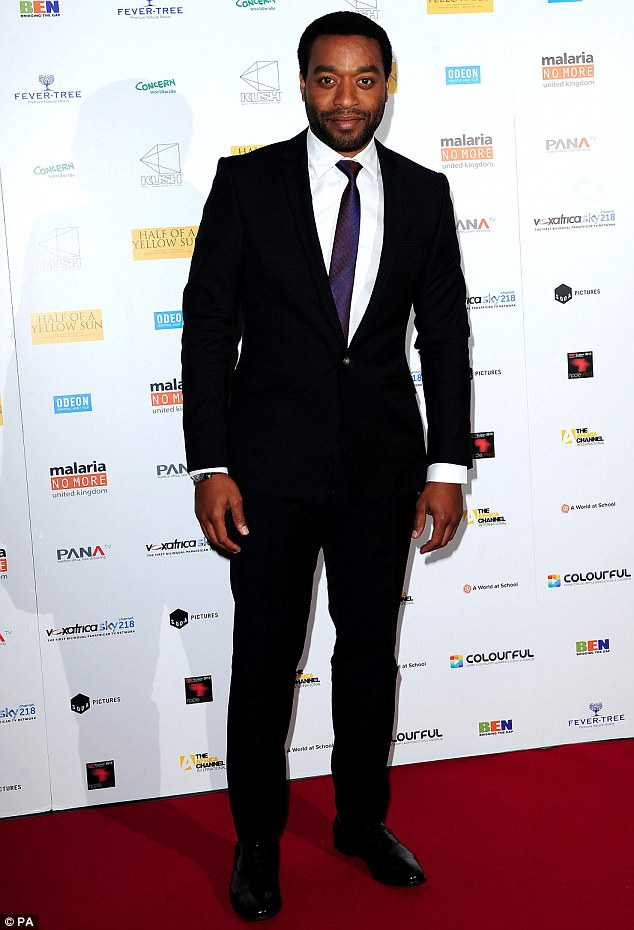 Suited and booted: Chiwetel looked rather dapper for the occasion in an immaculately tailored black two-piece suit, which he teamed with a crisp white shirt and an aubergine-coloured silk tie