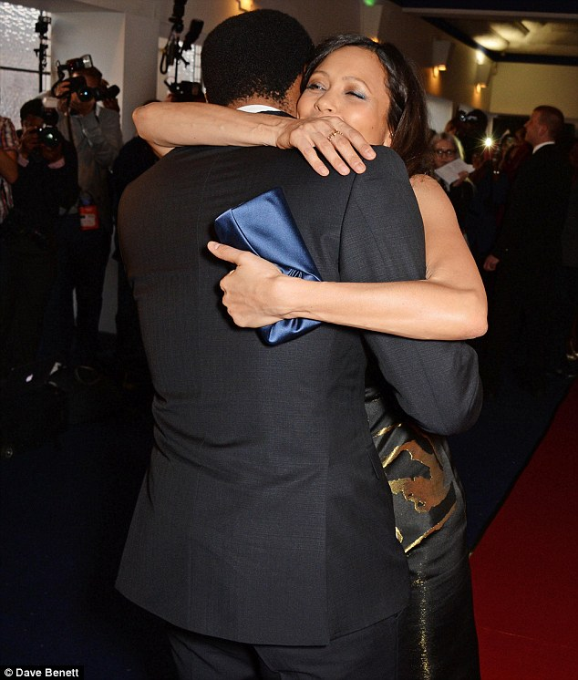 Happy reunion: Thandie and Chiwetel greeted one another with a warm embrace as they arrived at the South London cinema for their big night