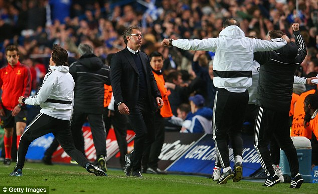 Contrasting emotions: Laurent Blanc can't believe it as Chelsea's coaching staff celebrate in the 87th minute