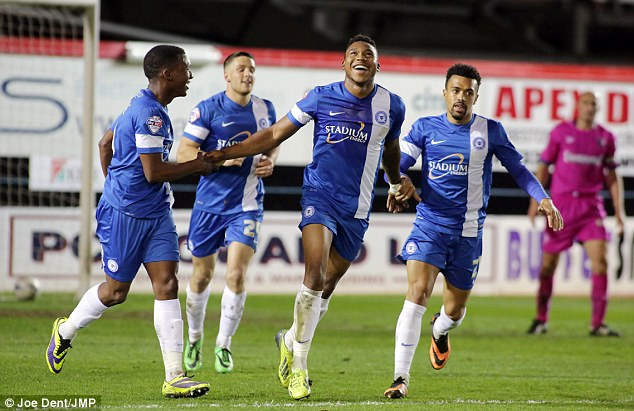 Britt of all right: Peterborough striker Assombalonga (second right) celebrates his goal