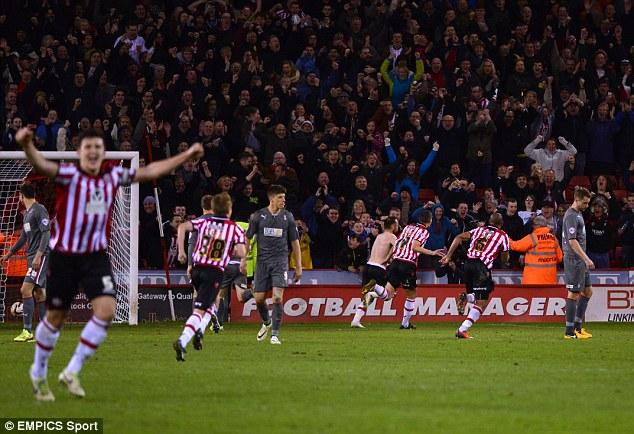 Last-gasp: Sheffield United celebrate Ben Davies' last minute winner against Rotherham