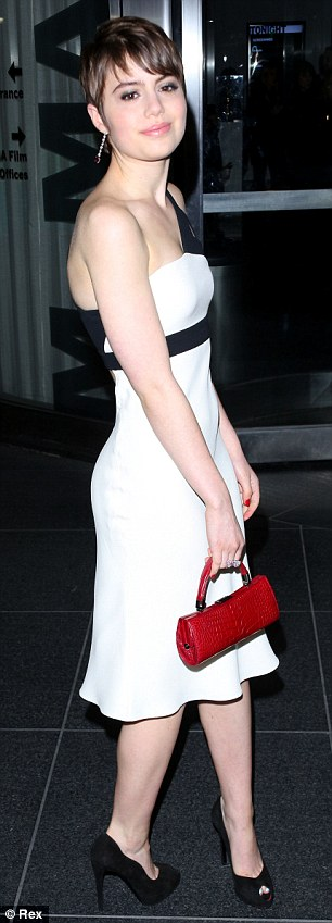 Black on white: The 18-year-old actress showed off a very slender figure in a flowing white dress with black peep-toe pumps