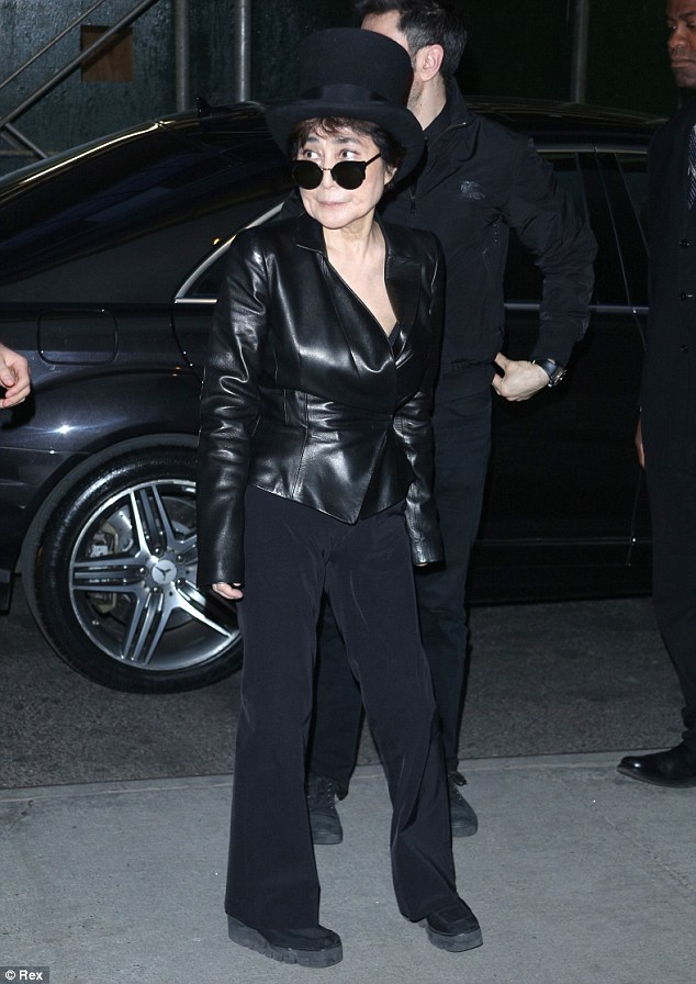 Back in black: Yoko Ono made an appearance in a black leather jacket teamed with black trousers and her signature top hat and dark sunglasses