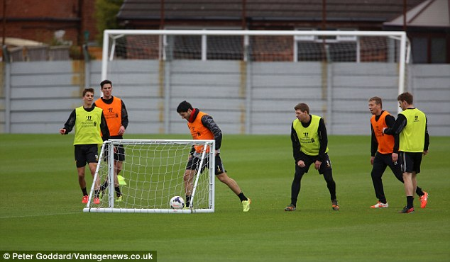 Too easy: Suarez grins as eh completes an easy tap-in during Liverpool training on Wednesday