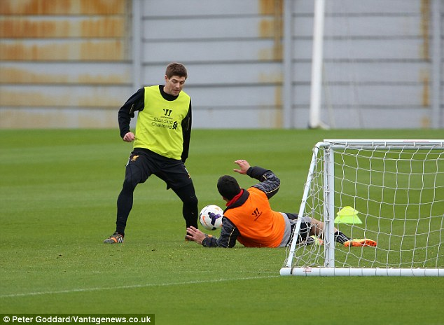 Different job: Suarez turns defender to deny captain Steven Gerrard in training