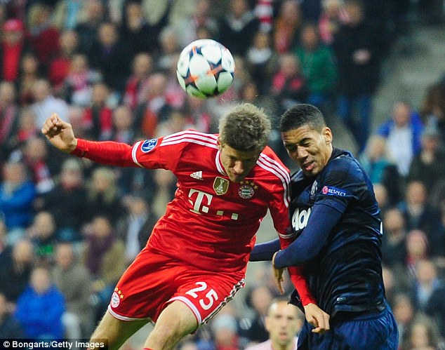 Steppingup: Chris Smalling (right) tussles with Thomas Muller as the centre back covered admirably