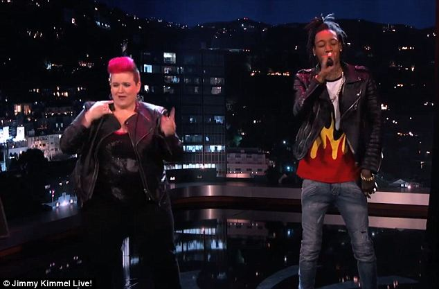 Big hit: Wiz Khalifa sang his number one hit Black and Yellow as the interpreters danced and signed along