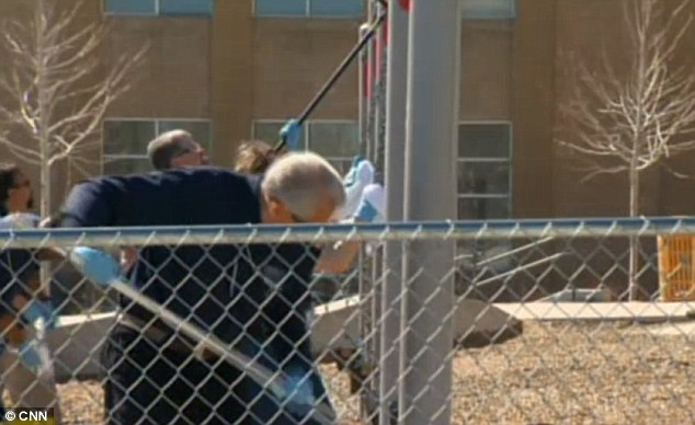 Cleaning up: The school was closed Tuesday so play equipment could be scrubbed clean
