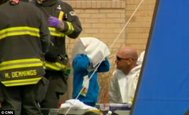 Decontaminated: Hazmat crews helped wash down the young students