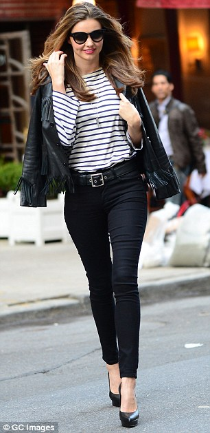 Work it! The supermodel wore a leather jacket, striped top, black skinny jeans and pumps for the fashion shoot