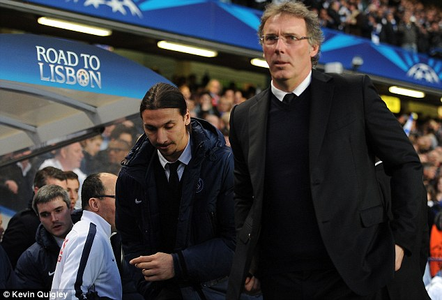 New boss: Ibrahimovic follows manager Laurent Blanc to his seat ahead of kick-off