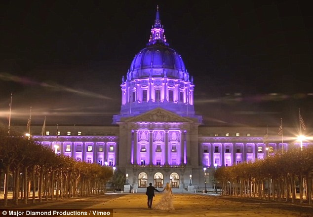 Happy couple: The save the date wedding video finishes with Mr Obaro and Miss Jentz walking down the tree-lined driveway of San Francisco's City Hall