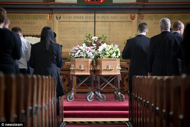 Joint goodbye: The coffins of Bert and Mary Barnsley lie side by side during their funeral