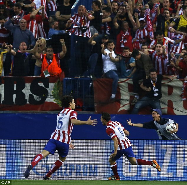 Happy days: Atletico fans go wild after Koke scores against Barcelona