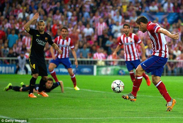 Early strike: Unmarked Koke scores for Atletico Madrid against Barcelona