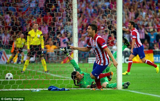 Delight: Koke of Atletico Madrid celebrates scoring the only goal of the night against Barcelona