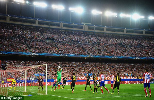 Safe hands: Barcelona keeper Jose Pinto collects the ball against Atletico Madrid