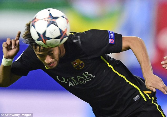 High ball: Barcelona's Neymar heads the ball at the Vicente Calderon