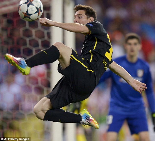 Chasing tails: Barcelona's Lionel Messi attempts to control the ball in mid-air