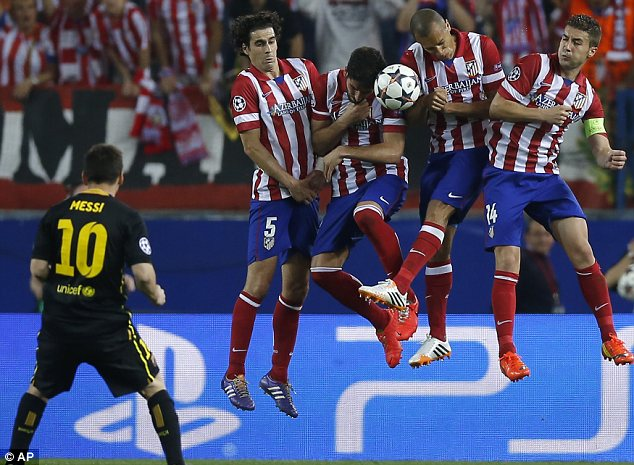No way: Barcelona's Lionel Messi has a free kick blocked by Atletico wall
