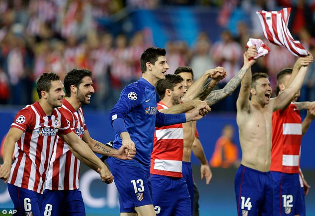 Hands up: Atletico players celebrate their victory over Barcelona