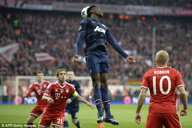 Head and shoulders above: Danny Welbeck rises to head the ball above Robben and Lahm
