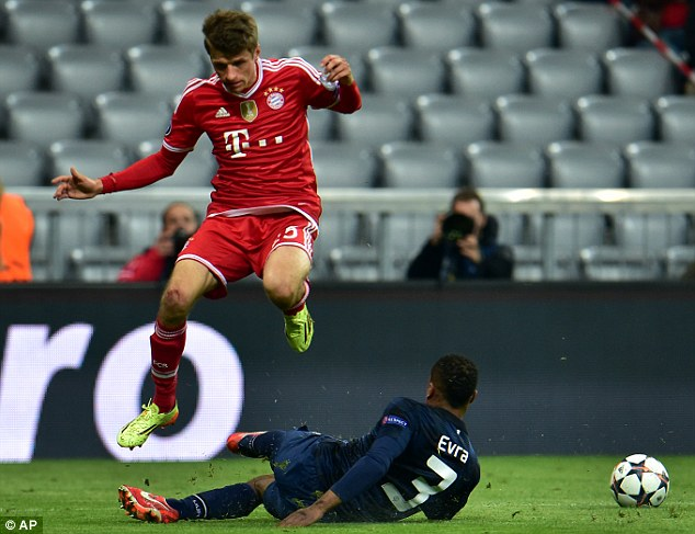 Up for it: Patrice Evra (right) prevents Bayern forward Thomas Muller getting through on goal