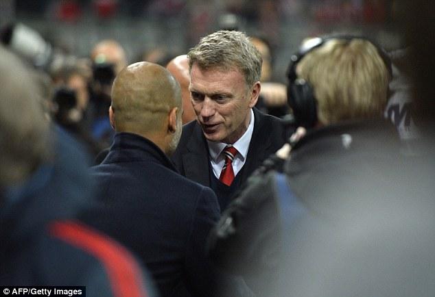 So we meet again: David Moyes and Pepe Guardiola share a word before the proceedings begin