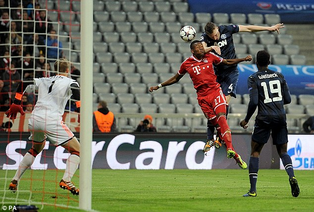 Red alert: Phil Jones climbs above David Alaba to get his attempt towards Neuer's goal