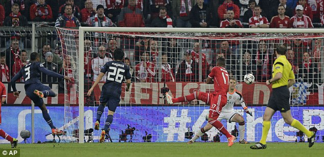 Pocket rocket: Evra's strike bounced off the bar and over Manuel Neuer's line to stun the hosts