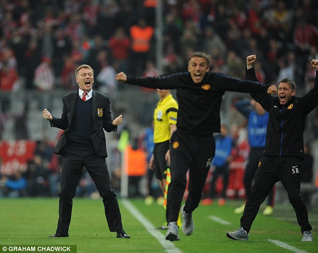 Ecstasy: David Moyes and Phil Neville leap off the bench after Evra opened the scoring