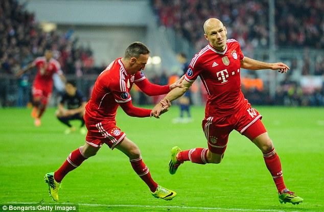 Me again: Arjen Robben wheels away after scoring Bayern Munich's third goal of the evening