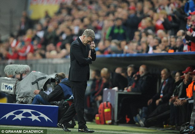 Game over: David Moyes turns away from the action with his head in his hands