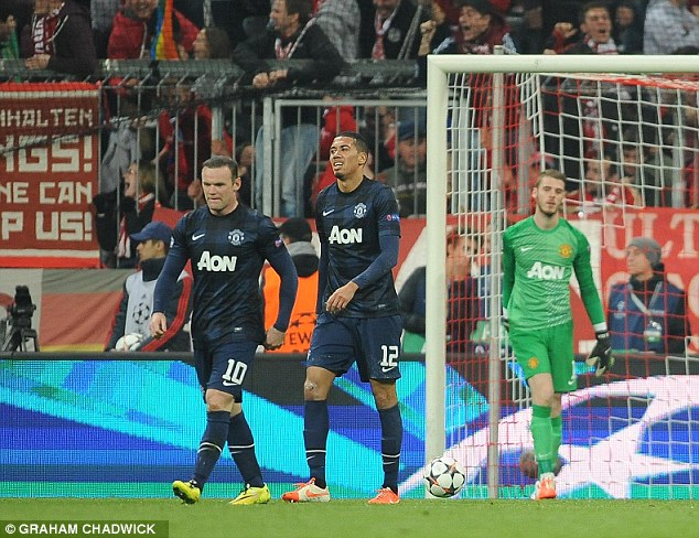 Over and out: Manchester United players trudge back to the centre circle after conceding
