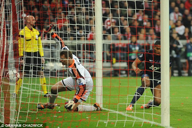Appeal: Manuel Neuer watches the ball cross the line but Antonio Valencia is ruled offside early in the game