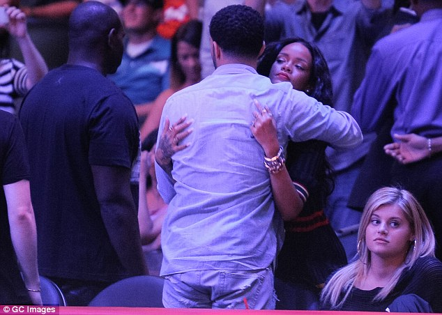 Rare PDA: The hip-hop power pair haven't been photographed together since embracing at the April 9 Los Angeles Clippers game at the Staples Center