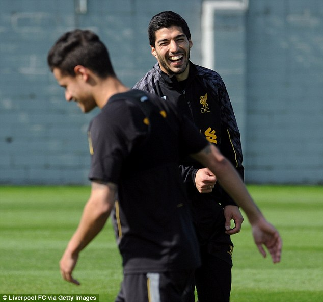 All smiles: Luis Suarez (back) was relaxed during the training session at Melwood