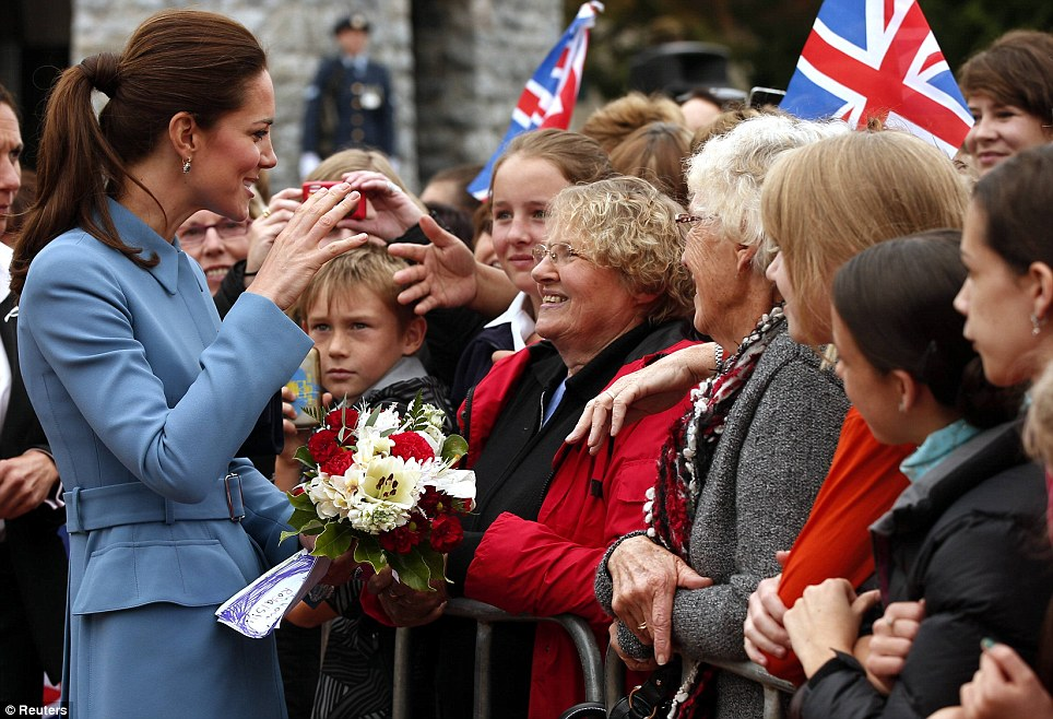 The Duchess looked delighted as she greeted members of the crowd and received a bouquet of flowers and a series of hand written cards