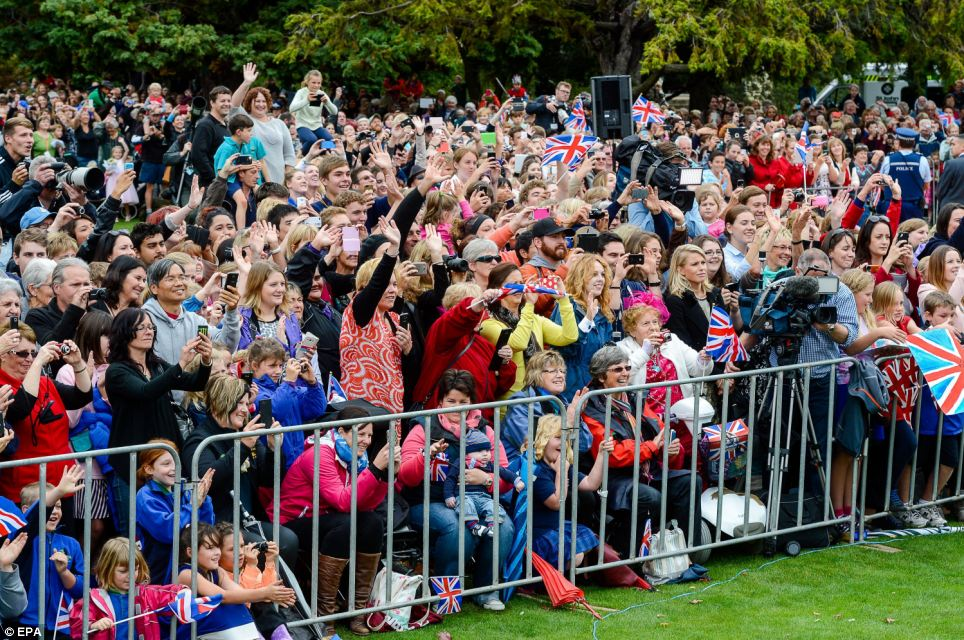 New Zealanders wave to the Duke and Duchess after the wreathlaying ceremony, each one trying to get their personal souvenir photograph on their phones