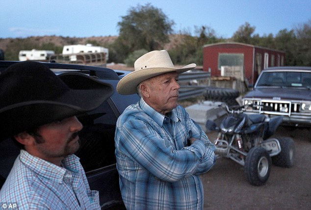 Defiance: Cliven Bundy, (right), and friend, Clance Cox, stand at the Bundy ranch near Bunkerville Nevada on Saturday during the escalation of their dispute with the Federal Government