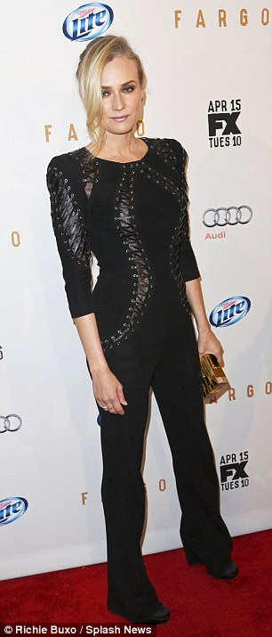 Edgy: The 37-year-old teamed the look with matching black pants, shoes and a gold clutch