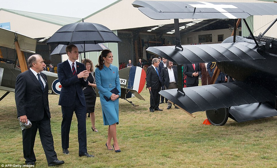 The royal couple had much to take in as the walked around the museum, sheltered by a large umbrella