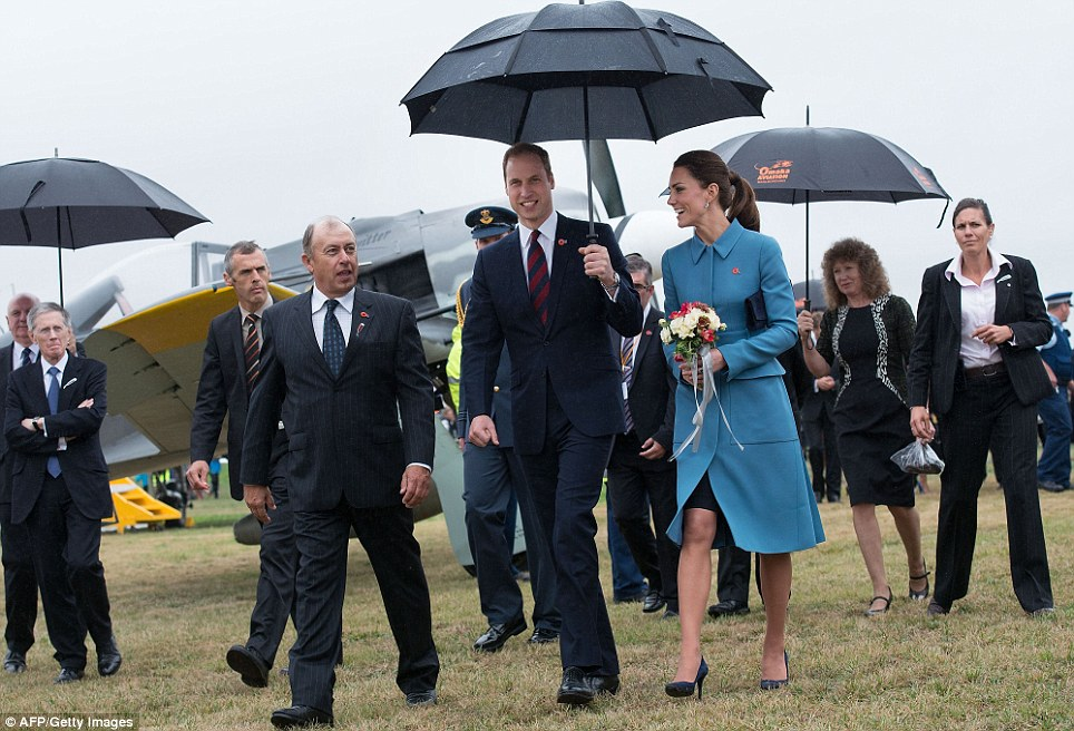 Just like England: a light drizzle didn't spoil the visit by the Duke and Duchess to the vintage aircraft centre outside the town of Blenheim where the couple was given a rapturous welcome by crowds earlier in the day