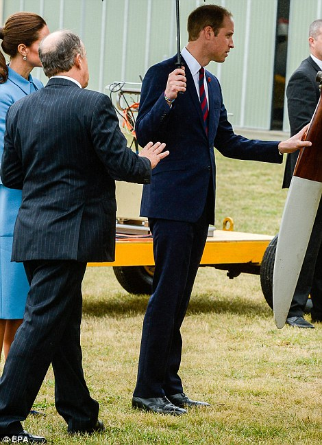The Duke inspects the propeller of a plane