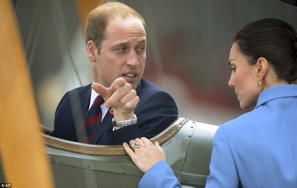 Prince William began pointing to Kate who was busy inspecting the veteran aircraft